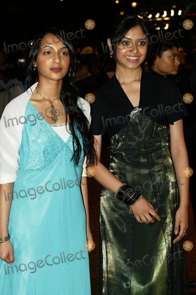Afshan Azad Photo - London Afshan Azed with escort  at the premiere of her  new film Harry Potter and the Goblet of Fire She plays Padma Patil   6th November 2005 Jenny Roberts Landmark Media