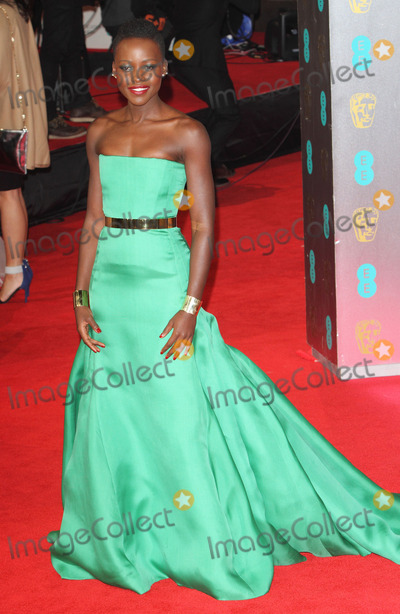 Lupita Nyongo Photo - London UK  Lupita Nyongo at the EE British Academy Film Awards 2014 (BAFTAS)  Red Carpet Arrivals at the Royal Opera House Covent Garden London 16th February 16th 2014 RefLMK73-47676-170214Keith MayhewLandmark MediaWWWLMKMEDIACOM