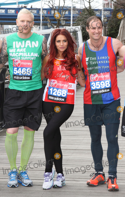 Andrew Strauss Photo - London UK   Iwan Thomas Amy Childs and Andrew Strauss  at the  London Marathon 2013 Celebrities Photocall outside the Tower Hotel London 17th April  2013Keith MayhewLandmark Media
