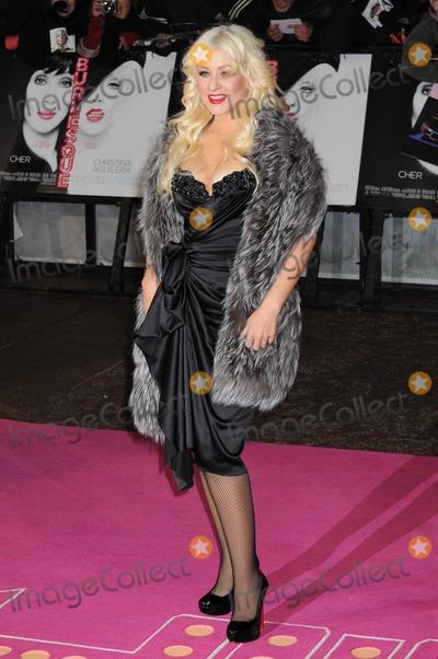 Christina Aguilera Photo - London UK Christina Aguilera ( wearing Stella McCartney dress ) at the UK film Premiere of Burlesque Leicester Square London UK 13th December 2010Matt LewisLandmark Media