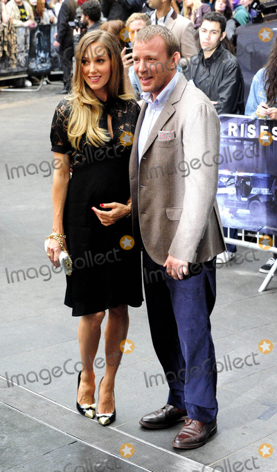 GUY RICHIE Photo - London UK Jacqui Ainsley and Guy Richie at the European premiere of The Dark Knight Rises held at Leicester Square 18th July 2012SydLandmark Media