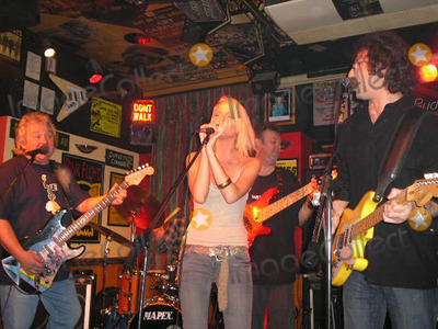 Alex Browne Photo - Stafford Staffordshire EXCLUSIVE  Sarah Harding (Centre) of Girls Aloud at the Grapes pub in Stafford on Boxing Day where she decided to go on stage and sing with her brother (R) Dangerous Dave Rea and the pub owner  Derek Holt (L) on guitar The rest of the band John Cuffley (drums)and Neil Simpson on bass  She sang with them for  20 minutes and sang songs like  Desperado and Drift Away   Sarah who comes from this area of England was there to spend Christmas with her family Photo taken 26th December 2005 NEWSPAPERS ONLY   Alex BrownLandmark Media   FOR MORE INFO ON THE GIG GO TO  wwwgrapesstaffordcouk