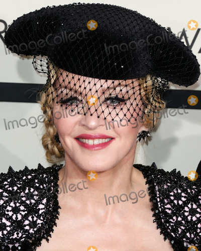 Givenchy Photo - (FILE) Madonna Says She Has Coronavirus COVID-19 Antibodies LOS ANGELES CALIFORNIA USA - FEBRUARY 08 Singer Madonna wearing Givenchy Haute Couture by Riccardo Tisci arrives at the 57th Annual GRAMMY Awards on February 8 2015 in Los Angeles California United States (Photo by Xavier CollinImage Press Agency)