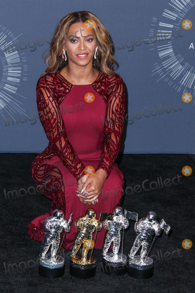 Beyonce Photo - (FILE) Beyonc named musics most powerful woman by BBC Womans Hour power list The superstar came first in a list of the industrys 40 most influential women thanks to her feminism activism and empowering musical messages INGLEWOOD LOS ANGELES CA USA - AUGUST 24 Singer Beyonce wearing a Zuhair Murad dress Christian Louboutin shoes and Lorraine Schwartz jewelry poses in the press room at the 2014 MTV Video Music Awards held at The Forum on August 24 2014 in Inglewood Los Angeles California United States (Photo by Xavier CollinImage Press Agency)
