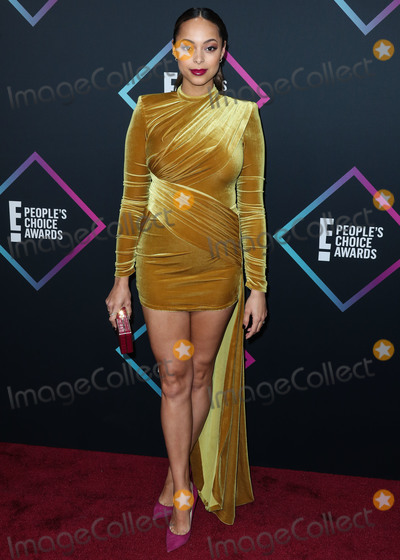 Amber Stevens Photo - SANTA MONICA LOS ANGELES CA USA - NOVEMBER 11 Actress Amber Stevens West wearing a Michael Costello dress Jimmy Choo shoes a Michael Kors clutch and Melinda Maria jewelry arrives at the Peoples Choice Awards 2018 held at Barker Hangar on November 11 2018 in Santa Monica Los Angeles California United States (Photo by Xavier CollinImage Press Agency)