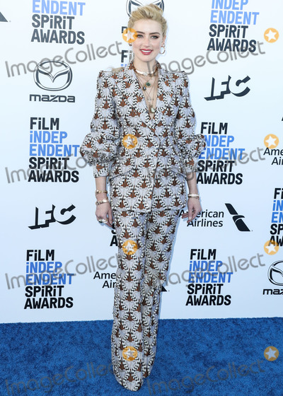 Amber Heard Photo - SANTA MONICA LOS ANGELES CALIFORNIA USA - FEBRUARY 08 Actress Amber Heard wearing a Fendi suit arrives at the 2020 Film Independent Spirit Awards held at the Santa Monica Beach on February 8 2020 in Santa Monica Los Angeles California United States (Photo by Xavier CollinImage Press Agency)
