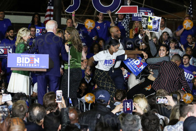 Vice President Joe Biden Photo - BALDWIN HILLS LOS ANGELES CALIFORNIA USA - MARCH 03 Former Vice President Joe Biden 2020 Democratic presidential candidate second left watches as his wife Jill Biden far left and staff members block a protester holding a sign that reads Let Dairy Die from arriving on stage during the Jill and Joe Biden 2020 Super Tuesday Los Angeles Rally held at the Baldwin Hills Recreation Center on March 3 2020 in Baldwin Hills Los Angeles California United States (Photo by Xavier CollinImage Press Agency)