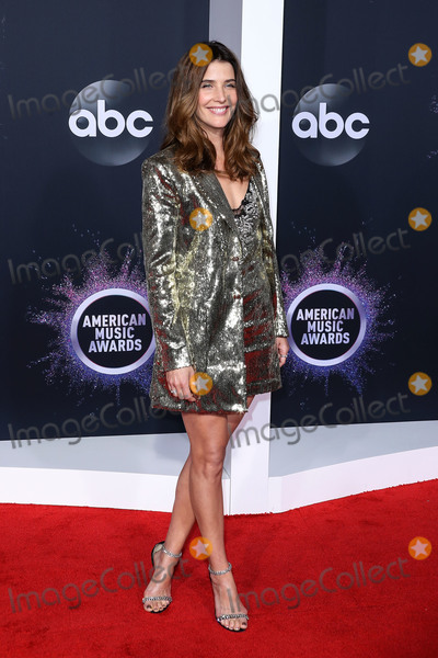 Coby Smulders Photo - LOS ANGELES CALIFORNIA USA - NOVEMBER 24 Actress Cobie Smulders wearing a Dundas outfit Jimmy Choo shoes and jewelry by Tiffany  Co while carrying a Jimmy Choo bag arrives at the 2019 American Music Awards held at Microsoft Theatre LA Live on November 24 2019 in Los Angeles California United States (Photo by Xavier CollinImage Press Agency)