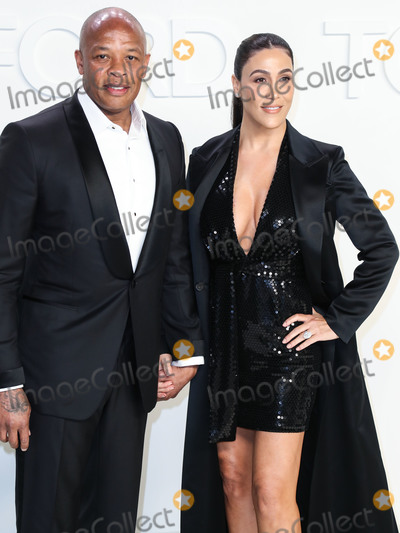 Dres Photo - HOLLYWOOD LOS ANGELES CALIFORNIA USA - FEBRUARY 07 Dr Dre and Nicole Young arrive at the Tom Ford AutumnWinter 2020 Fashion Show held at Milk Studios on February 7 2020 in Hollywood Los Angeles California United States (Photo by Xavier CollinImage Press Agency)