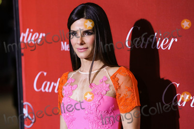 Jimmy Choo Photo - (FILE) Sandra Bullock Donates 6000 N95 Masks To Los Angeles Hospitals Amid Coronavirus COVID-19 Pandemic PALM SPRINGS RIVERSIDE CALIFORNIA USA - JANUARY 04 Actress Sandra Bullock wearing an Alex Perry dress Brian Atwood shoes and a Jimmy Choo purse arrives at the 25th Annual Palm Springs International Film Festival Awards Gala held at the Palm Springs Convention Center on January 4 2014 in Palm Springs Riverside California United States (Photo by Xavier CollinImage Press Agency)