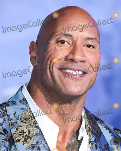 THE ROCK Photo - HOLLYWOOD LOS ANGELES CALIFORNIA USA - DECEMBER 09 Actor Dwayne Johnson (The Rock) wearing Dolce  Gabbana arrives at the World Premiere Of Columbia Pictures Jumanji The Next Level held at the TCL Chinese Theatre IMAX on December 9 2019 in Hollywood Los Angeles California United States (Photo by Xavier CollinImage Press Agency)