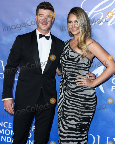 Robin Thicke Photo - BEVERLY HILLS LOS ANGELES CALIFORNIA USA - FEBRUARY 06 Robin Thicke and partner April Love Geary arrive at the 2020 Hollywood For The Global Ocean Gala Honoring HSH Prince Albert II Of Monaco held at the Palazzo di Amore on February 6 2020 in Beverly Hills Los Angeles California United States (Photo by Xavier CollinImage Press Agency)