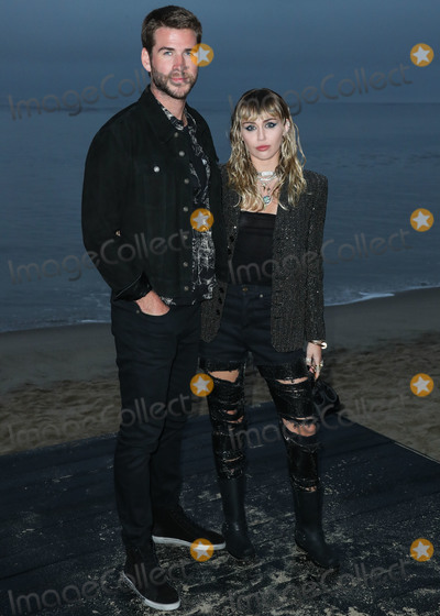Miley Cyrus Photo - MALIBU LOS ANGELES CALIFORNIA USA - JUNE 06 Actor Liam Hemsworth and singerwife Miley Cyrus arrive at the Saint Laurent Mens Spring Summer 20 Show held at Paradise Cove Beach on June 6 2019 in Malibu Los Angeles California United States (Photo by Xavier CollinImage Press Agency)
