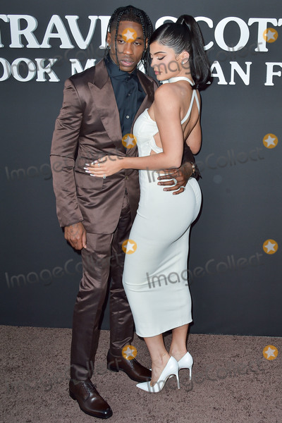 Travis Scott Photo - SANTA MONICA LOS ANGELES CALIFORNIA USA - AUGUST 27 Rapper Travis Scott and girlfriendtelevision personality Kylie Jenner arrive at the Los Angeles Premiere Of Netflixs Travis Scott Look Mom I Can Fly held at Barker Hangar on August 27 2019 in Santa Monica Los Angeles California United States (Photo by Image Press Agency)