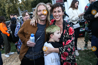 Alanis Morissette Photo - CALABASAS LOS ANGELES CA USA - DECEMBER 02 Taylor Hawkins Alanis Morissette and Ever Imre Morissette-Treadway at the One Love Malibu Festival Benefit Concert For Woolsey Fire Recovery held at the King Gillette Ranch on December 2 2018 in Calabasas Los Angeles California United States (Photo by Xavier CollinImage Press Agency)