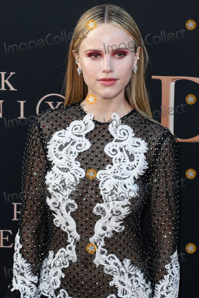 Halston Sage Photo - HOLLYWOOD LOS ANGELES CALIFORNIA USA - JUNE 04 Actress Halston Sage wearing a Raisa and Vanessa dress Casadei shoes a LAfshar clutch and Anita Ko jewelry arrives at the Los Angeles Premiere Of 20th Century Foxs Dark Phoenix held at the TCL Chinese Theatre IMAX on June 4 2019 in Hollywood Los Angeles California United States (Photo by Xavier CollinImage Press Agency)