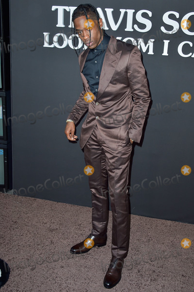 Travis Scott Photo - SANTA MONICA LOS ANGELES CALIFORNIA USA - AUGUST 27 Rapper Travis Scott arrives at the Los Angeles Premiere Of Netflixs Travis Scott Look Mom I Can Fly held at Barker Hangar on August 27 2019 in Santa Monica Los Angeles California United States (Photo by Image Press Agency)