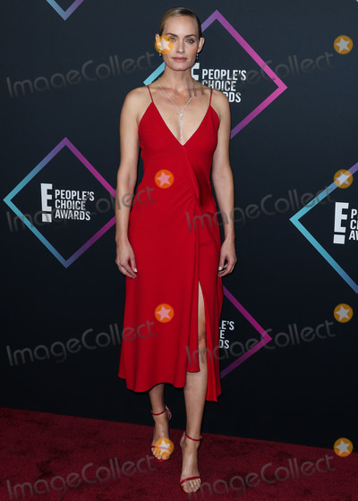 Amber Valletta Photo - SANTA MONICA LOS ANGELES CA USA - NOVEMBER 11 Actress Amber Valletta wearing a Victoria Beckham dress arrives at the Peoples Choice Awards 2018 held at Barker Hangar on November 11 2018 in Santa Monica Los Angeles California United States (Photo by Xavier CollinImage Press Agency)