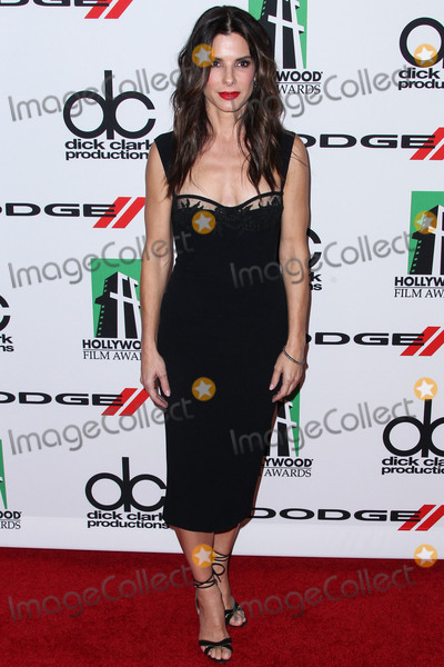 Jewel Photo - (FILE) Sandra Bullock Donates 6000 N95 Masks To Los Angeles Hospitals Amid Coronavirus COVID-19 Pandemic BEVERLY HILLS LOS ANGELES CALIFORNIA USA - OCTOBER 21 Actress Sandra Bullock wearing a DSquared2 Pink  Black dress and Martin Katz jewels arrives at the 17th Annual Hollywood Film Awards held at The Beverly Hilton Hotel on October 21 2013 in Beverly Hills Los Angeles California United States (Photo by Xavier CollinImage Press Agency)