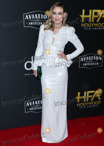 Michael Kors Photo - BEVERLY HILLS LOS ANGELES CALIFORNIA USA - NOVEMBER 03 Actress Olivia Wilde wearing a Michael Kors dress Jimmy Choo shoes and Tabayer jewelry while carrying a Tyler Ellis clutch arrives at the 23rd Annual Hollywood Film Awards held at The Beverly Hilton Hotel on November 3 2019 in Beverly Hills Los Angeles California United States (Photo by Xavier CollinImage Press Agency)
