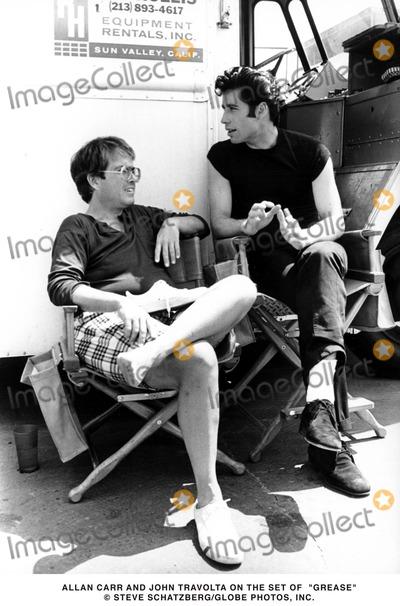Allan Carr Photo - Allan Carr and John Travolta on the Set of Grease Steve SchatzbergGlobe Photos Inc