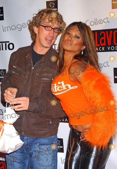 Traci Bingham Photo - Von Dutch Party For Christian Audigiers Birthday Celebration at a Private Residence Hollywood California 05212004 Photo by Miranda ShenGlobe Photos Inc 2004 Andy Dick and Traci Bingham