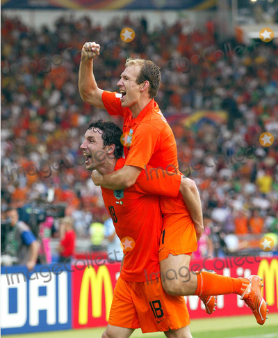 Arjen Robben Photo - Mark Van Bommel  Arjen Robben Cellebrate Win Holland V Ivory Coast World Cup Soccer 06-16-2006 Photo by Allstar-Globe Photos