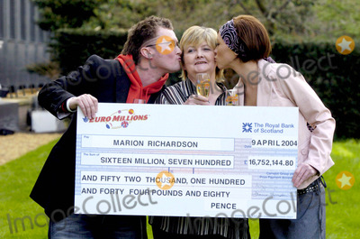 Atomic Kitten Photo - 00068657-YEAR OLD GRANDMOTHER MARION RICHARDSON WON 167 MILLION ON THE EURO LOTTERY LAST FRIDAY FORMER ATOMIC KITTEN STARS NATASHA HAMILTON  AND LIZ MCCLARNON HANDED OVER THE CHECK YESTERDAY THE SINGERS HAVE KNOWN MARION FOR FIVE YEARS SINCE HER SON SCOTT IS A POP PROMOTER WHOS ACTS INCLUDED THE GIRL BANDPICTURED MARION RICHARDSON (MIDDLE) SON SCOT (LEFT) AND NATASHA HAMILTON (RIGHT)GATESHEAD ENGLAND4132004PHOTO BYGUS HEDGESGlobelinkUKGLOBE PHOTOS INC  2004K36666