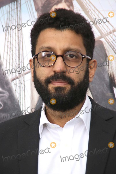 Adeel Akhtar Photo - Adeel Akhtar attends the Red Carpet Arrivals For the Premiere of Pan the Ziegfeld Theater NYC October 4 2015 Photos by Sonia Moskowitz Globe Photos Inc