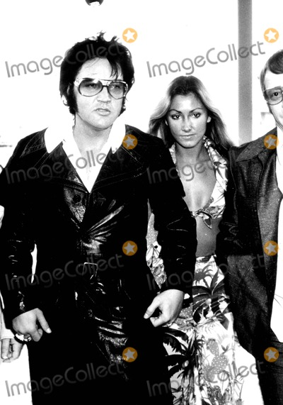 Red West Photo - Elvis Presley and Linda Thompson in Las Vegas (Red West Bodyguard Is Partly Visible) 9709 Supplied by IpolGlobe Photos Inc