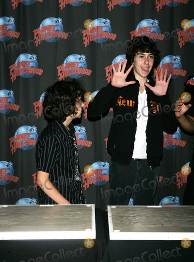 Alex Wolff Photo - Alex Wolff (L) and Nat Wolff (Naked Brothers Band) Promote Their Nickelodeon Series and Summer Tour with a Handprint Ceremony at Planet Hollywood in Times Square in New York on June 4 2009 Photo by Terry GatanisGlobe Photos Inc