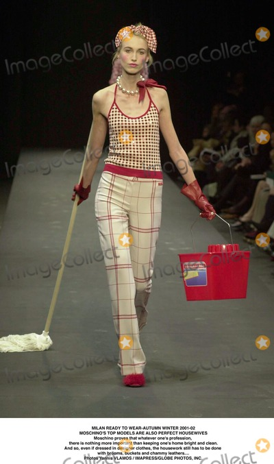 Nothing More Photo - MILAN READY TO WEAR-AUTUMN WINTER 2001-02MOSCHINOS TOP MODELS ARE ALSO PERFECT HOUSEWIVESMoschino proves that whatever ones profession there is nothing more important than keeping ones home bright and cleanAnd so even if dressed in designer clothes the housework still has to be done with brooms buckets and chammy leathersPhotos Yannis VLAMOS  IMAPRESSGLOBE PHOTOS INC