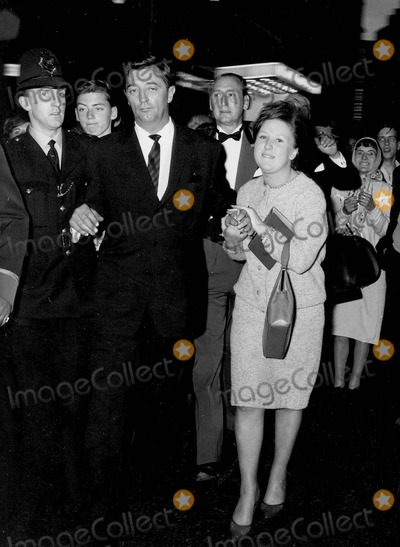 Robert Mitchum Photo - Robert Mitchum Was Mobbed by Fans When He Left the Leicester Square Theatre After He Had Presented Awards to a Number of Stars Who Had Appeared in the Film the Longest Day 06-06-1963 Supplied by Globe Photos Inc