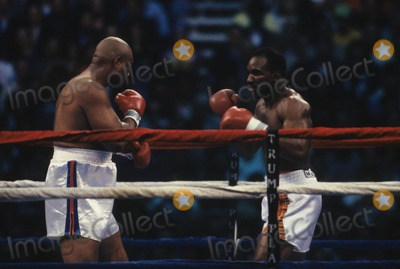 George Foreman Photo - Evander Holyfield Vs George Foreman at the Trump Plaza Atlantic City 1991 L1387 Photo by John Barrett-Globe Photos Inc