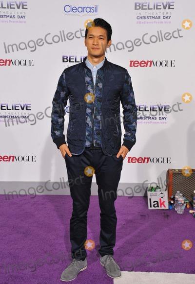 Harry Shum Jr Photo - Harry Shum Jr attending the World Premiere of Justin Biebers Believe Held at the Regal Cinemas LA Live in Los Angeles California on December 18 2013 Photo by D Long- Globe Photos Inc