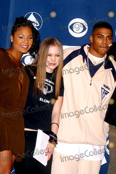 Avril Lavigne Photo - Sd010703 45th Annual Grammy Awards Nominations Announcements at Madison Square Garden NYC Photo by John BarrettGlobe Photosinc 2003 Ashanti and Avril Lavigne and Nelly