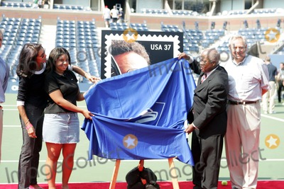 Arthur Ash Photo - Arthur Ashe Commemorative Stamp Unveiled During Arthur Ashe Kids Day at the Usta National Tennis Center in Queens New York 08282004 Photo by Rick MacklerrangefinderGlobe Photos Inc 2004 Jeannie Ashe Carmen Ashe and Henry Apankey