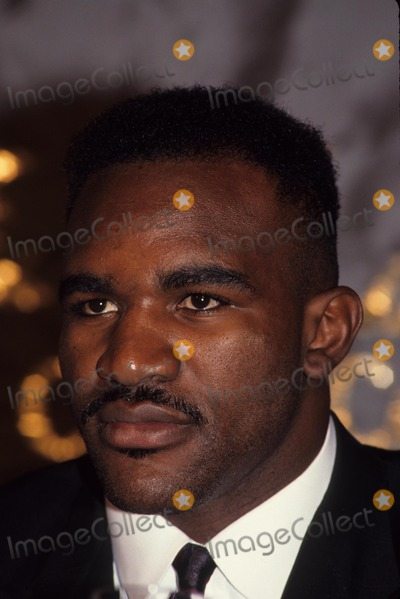 George Foreman Photo - Evander Holyfield with George Foreman Press Conference at Grand Hyatt in New York 1990 Photo by John Barrett-Globe Photos Inc
