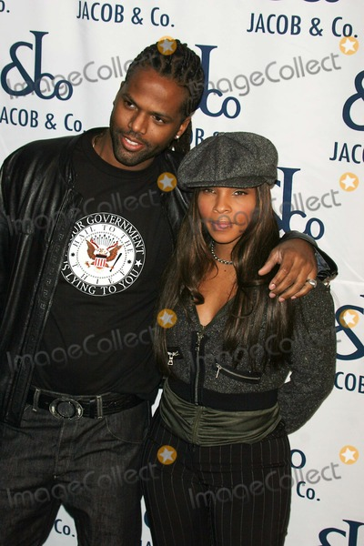 AJ FREE Photo - Jacob the Jeweler to Celebrate the Grand Opening of the  Jacob  CO Flagship Boutique  in New York City 12-13-2004 Photo by John Barrett-Globe Photos Inc 2004 Aj Calloway and Free ( Bet 106 and Park )