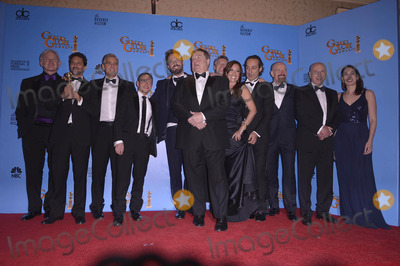 Alexandre Desplat Photo - Pictured (l-r) Actor Victor Garber Producers Grant Heslov and George Clooney Writer Chris Terrio Director Ben Affleck Actors John Goodman Tate Donovan Producer Chay Carter Composer Alexandre Desplat Actors Bryan Cranston Alan Arkin in the Pressroom at the 70th Golden Globe Awards at the Beverly Hilton Hotel on January 13 2013 in Beverly Hills CA Photos by Joe White-Globe Photos Inc