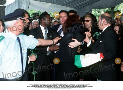 As Yet Photo - IMAPRESS PH  BENITO  CLEMOTFUNERAL OF PRINCESS LEILA PAHLAVI IN PARIS 16TH JUNE 2001 IN TOTAL BEREAVEMENT THE EX-EMPRESS OF IRAN FARAH PAHLAVI BURIED HER DAUGHTER IN THE PASSY CEMETERY IN PARIS LEILA PAHLAVI 31 PASSED AWAY A WEEK AGO IN LONDON THE OFFICIAL COMMUNIQUE WRITTEN BY HER MOTHER INDICATED THAT SHE PASSED AWAY IN HER SLEEP BUT THE EXACT CIRCUMSTANCES OF THE DEACEASED REMAIN AS YET UNKNOWNA HYSTERICAL ONLOOKER THROWS HER SELF INTO EMPRESS FARAHS ARMS BEFORE BEING LED OUT OF THE CEMETERYCREDIT IMAPRESSCLEMOTBENITOGLOBE PHOTOS INC