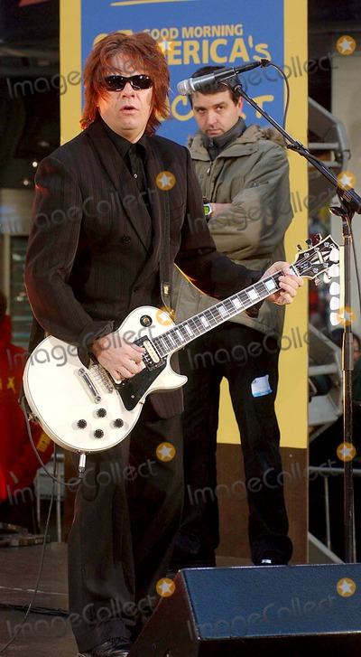 Andy Taylor Photo - 1204 Outside Abc Studio-times Square NYC Duran Duran Performs on Good Morning America Andy Taylor Photo Byken BabolcsayipolGlobe Photos Inc 2004