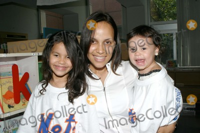 Angel Pagan Photo - The New York Mets and Citi Participate in New York Citys Summer Reading Program with Two NY Mets Angel Pagans Wfe and Daughters at the Brooklyn Public Library Brooklyn NY 07-28-2009 Photo by Bruce Cotler -Globe Photos Inc 2009
