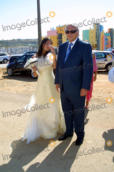 Hugo Viana Photo - 20030628 ALBUFEIRA PORTUGAL The arrival of the bride with her father Helder at Orada chapel in Albufeira Algarve Hugo Viana the portuguese star of NewCastle 20 invited to his marriage with Raquel Gomes only the family and some close friends as Beto ex-collegue from Sporting Raquel is natural from Armacao de Pera Algarve The honeymoon will be in MaldivasPHOTO CITYFILESGLOBE PHOTOS INCK31480