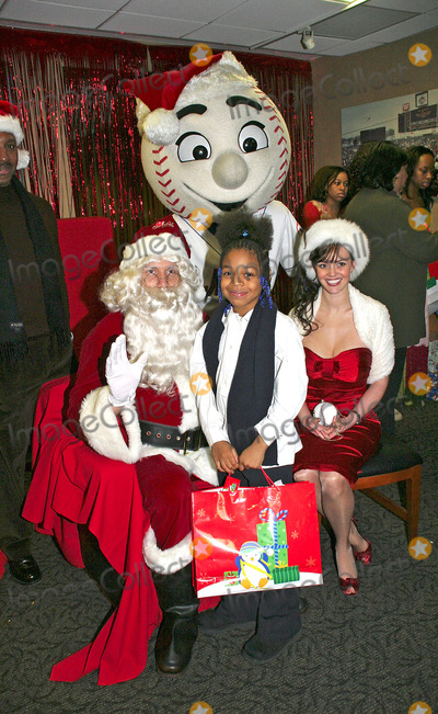 ANNA BENSON Photo - 1405 - Mets Host Annual Holiday Party For Local Children at Shea Stadium Pictured Here Is Anna Benson Who Accompanied Her Husband Kris Santa Benson and One of the Children I10344bt Photo by Barry Talesnick-ipol-Globe Photos