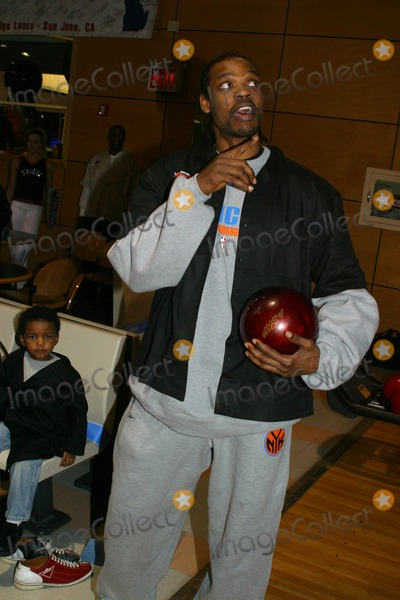 Latrell Sprewell Photo - Knicks Bowl 4 - the New York Knicks Annual Fundraiser to Benefit the Red Holzman Knicks Cheering For Kids Foundation at Chelsea Piers Lanes in New York City 03123003 Photo by Rick MacklerrangefinderGlobe Photos Inc 2003 Latrell Sprewell