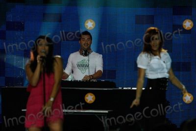 Anggun Photo - Dj Laurent Wolf (Center Behind) and Singer Anggun (in Pink) Performing at the World Music Awards at Sporting Club in Monte Carlo Monaco on November 9th 2008 Photo by Alec Michael-Globe Photos