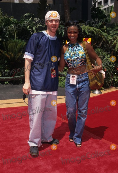 Jonathan Brandis Photo - Jonathan Brandis with Tatyana Ali Jurassic Park the Ride Opens at Universal Studios 1996 K5350lr Photo by Lisa Rose-Globe Photos Inc