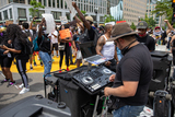 Photo - DJ Chris Legend plays music during a march against police brutality and racism in Washington DC on Saturday June 6 2020Credit Amanda Andrade-Rhoades  CNPAdMedia