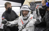 Photo - Japan Aerospace Exploration Agency (JAXA) astronaut Soichi Noguchi is helped out of the SpaceX Crew Dragon Resilience spacecraft onboard the SpaceX GO Navigator recovery ship after he NASA astronauts Mike Hopkins Shannon Walker and Victor Glover landed in the Gulf of Mexico off the coast of Panama City Florida Sunday May 2 2021 NASAs SpaceX Crew-1 mission was the first crew rotation flight of the SpaceX Crew Dragon spacecraft and Falcon 9 rocket with astronauts to the International Space Station as part of the agencys Commercial Crew Program Mandatory Credit Bill Ingalls  NASA via CNPAdMedia
